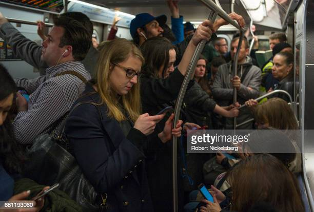 Passengers on the New York City subway crowd together during evening rush hour May 5 2017 in the Manhattan borough of New York City The New York...