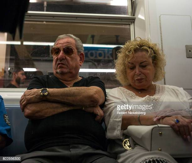 Passengers on the New York City subway sit during a morning rush hour commute in the Brooklyn borough of New York City July 13 2017 The New York...