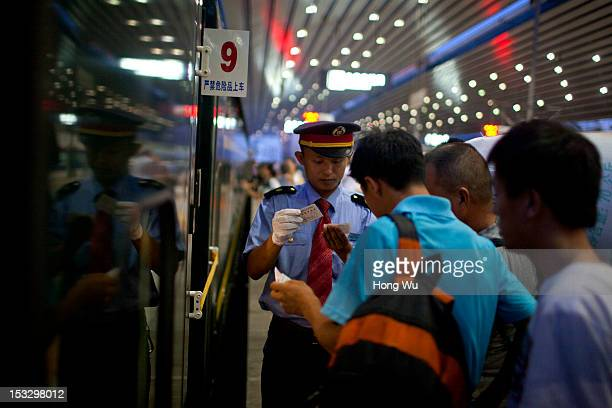 Passengers on the platform taking a train from Beijing to Lhasa at Beijing Railway Station on August 13 2012 in Beijing China After QinghaiTibet...