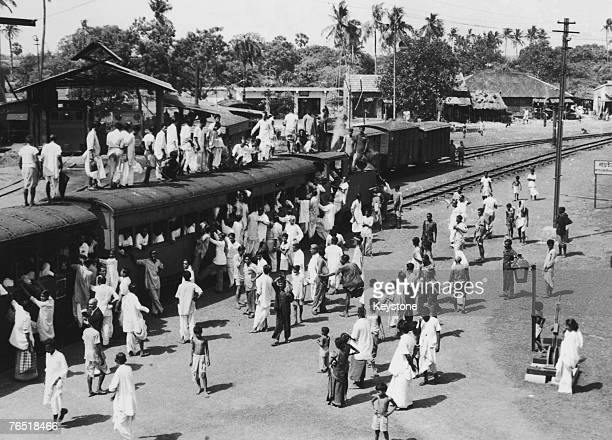 Passengers on the roof of a train at Basirhat station on the BarasatBasirhat Railway 17th June 1955 The line opening in 1914 in West Bengal is about...
