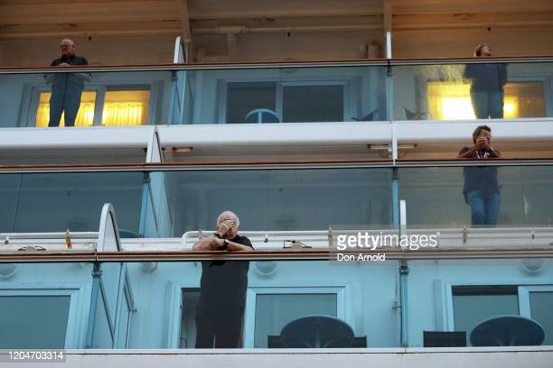 Passengers on the Ruby Princess can be seen as it docks at Overseas Passenger Terminal on February 08, 2020 in Sydney, Australia. Authorities around...