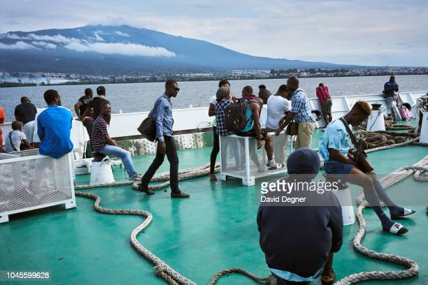 Passengers on the San Valentine Ferry on August 19 2018 in Malabo Equatorial Guinea Pico Basilé located on the island of Bioko can be seen in the...