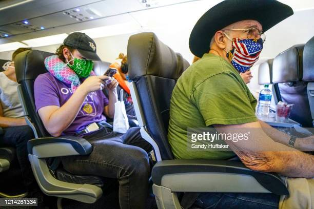 Passengers onboard an American Airlines flight to Charlotte NC at San Diego International Airport on May 20 2020 in San Diego California Air travel...