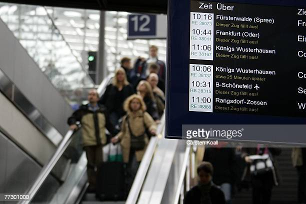 Passengers pass a display for the train status at Hauptbahnhof train station during a nationwide strike of the German locomotive drivers union the...