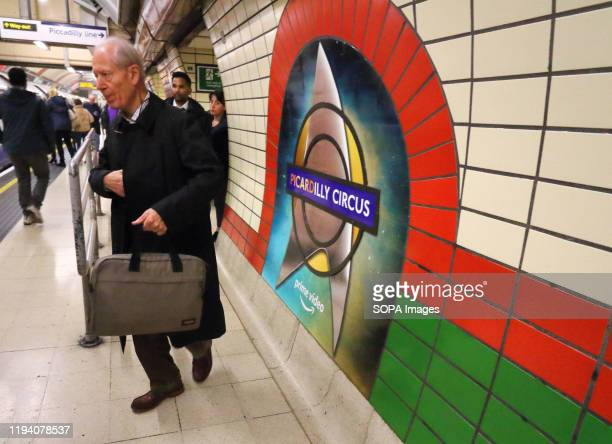 Passengers pass by the Roundels showing the new display of Star Trek insignia on the platforms For 48 hours London's tube system has a 'new' station...
