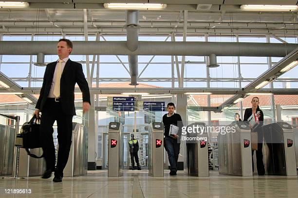 Passengers pass through electronic ticket gates at Gautrain's Hatfield mass transit rail station in Pretoria South Africa on Monday Aug 22 2011 South...