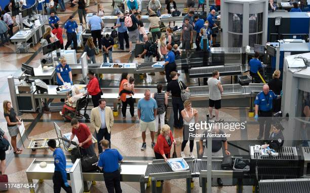 Passengers pass through the TSA security checkpoints prior to boarding their flights at Denver International Airport in Denver Colorado