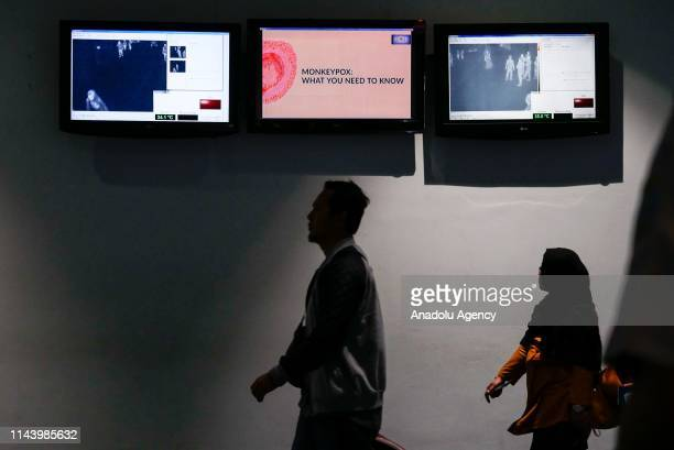 Passengers passing a monkeypox virus information at SoekarnoHatta International Airport in Tangerang near Jakarta Indonesia on May 15 2019 Monkeypox...