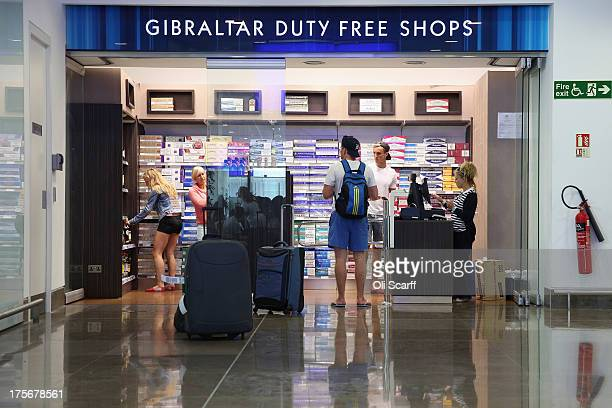 Passengers peruse a dutyfree shop in the terminal building of Gibraltar International Airport on August 6 2013 in Gibraltar Tensions between the...