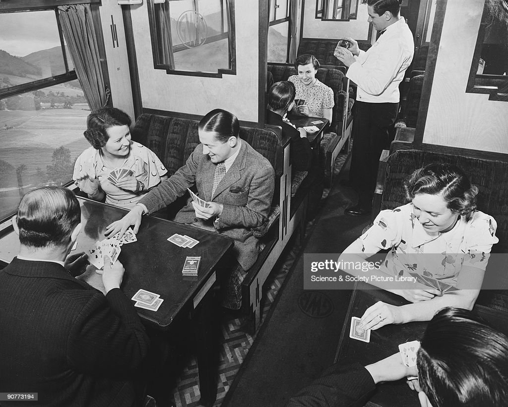 Passengers playing cards in a third class carriage, February 1938. : News Photo