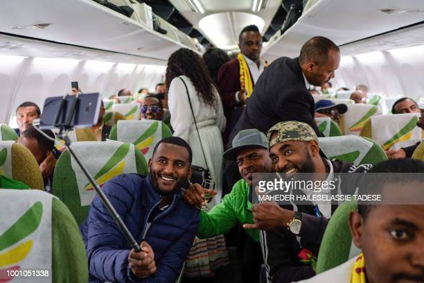 Passengers pose for a selfie picture inside an Ethiopian Airlines flight who departed from the Bole International Airport in Addis Ababa Ethiopia to...
