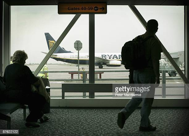 Passengers prepare to board a low cost flight from Stansted airport on May 15, 2006 in London. Low cost airlines are increasing their market share in...