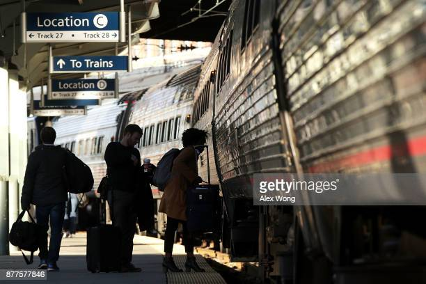 Passengers prepare to board a train at Union Station on November 22, 2017 in Washington, DC. The American Automobile Association has predicted that...