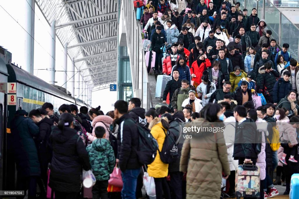 Passengers prepare to board the train as they started to return to school and work at Bozhou Railway Station on February 20, 2018 in Bozhou, Anhui Province of China. Bozhou Railway Station sees travel peak on the fifth day of the Lunar New Year.