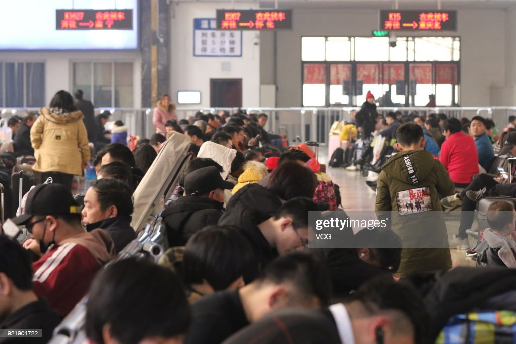 Passengers prepare to board the train as they started to return to school and work at Zhengzhou Railway Station on February 20, 2018 in Zhengzhou, Henan Province of China. Zhengzhou Railway Station sees travel peak on the fifth day of the Lunar New Year.