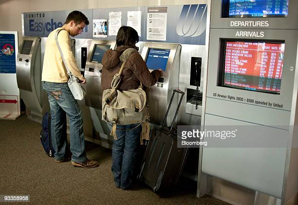 Passengers print out boarding passes at DallasFort Worth International Airport in Dallas Texas US on Tuesday Nov 24 2009 Americans will pack planes...