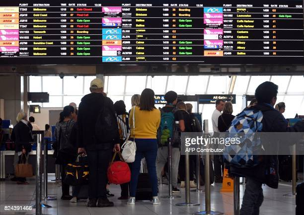 Passengers queue at a security check point at Sydney Airport on July 30 2017 Australia has foiled an Islamistinspired 'terrorist plot' to bring down...