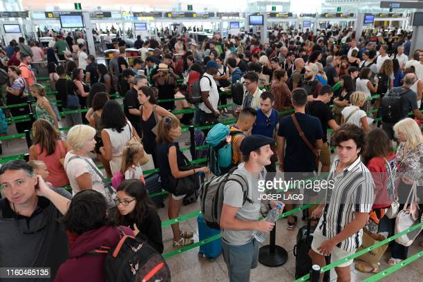 Passengers queue at El Prat airport in Barcelona amid an openended strike by security staff on August 9 2019