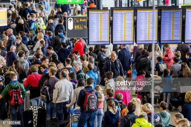 Passengers queue for checkin at Schiphol Airport in Amsterdam The Netherlands on April 22 2017 Due to the May holidays it is extra busy at the...