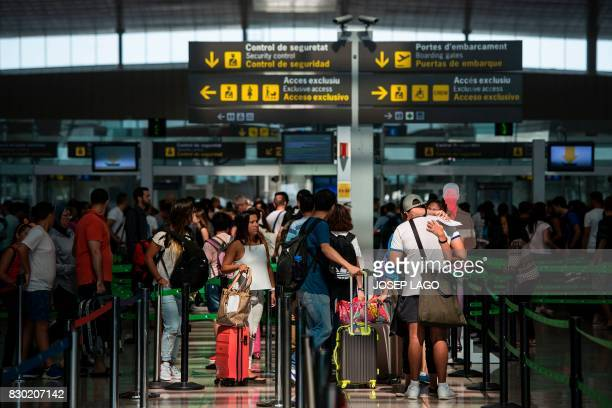 Passengers queue for passing the security control at Barcelona's El Prat airport on August 11 2017 Spain today called in police to help with security...