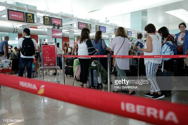 Passengers queue in front of checkin counters of Spanish airline Iberia at Barcelona's 'El Prat' airport on July 27 2019 A weekend strike by ground...