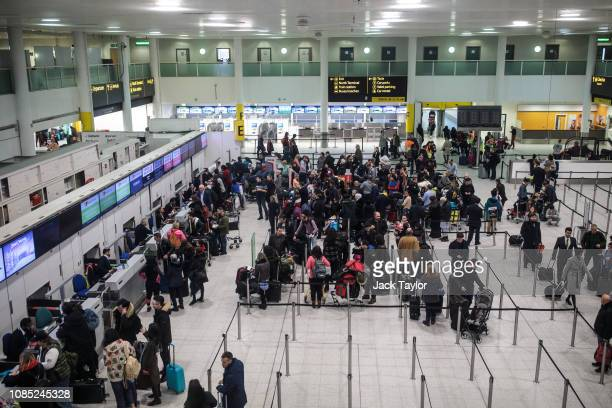 Passengers queue in the South Terminal building at London Gatwick Airport after flights resumed today on December 21, 2018 in London, England....