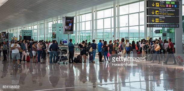 Passengers queue to board a Vueling flight in Terminal 1 of El Prat Airport Barcelona Spain 06 September 2015 Vueling Airlines is a Spanish lowcost...
