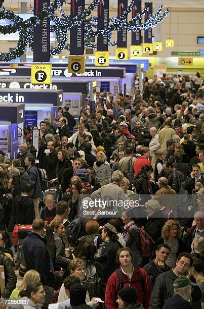 Passengers queue to checkin at terminal 1 of Heathrow Airport on December 19 2006 in London England Over the Christmas and New Year period London's...