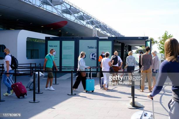 Passengers queue to do a health test before entering the Brussels airport on July 29 2020 in Zaventem Belgium Brussels Airport says it is forbidden...