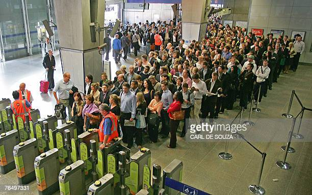 Passengers queue to enter the Underground station at Waterloo Station in central London 04 September 2007 as commuters battled with severe transport...