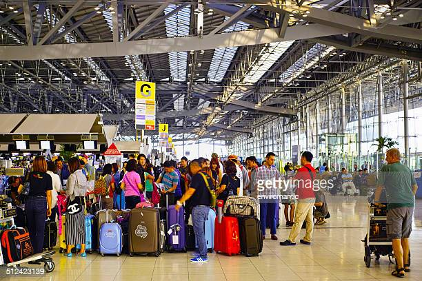 Passengers queuing for check in at Suvarnabhumi Airport.