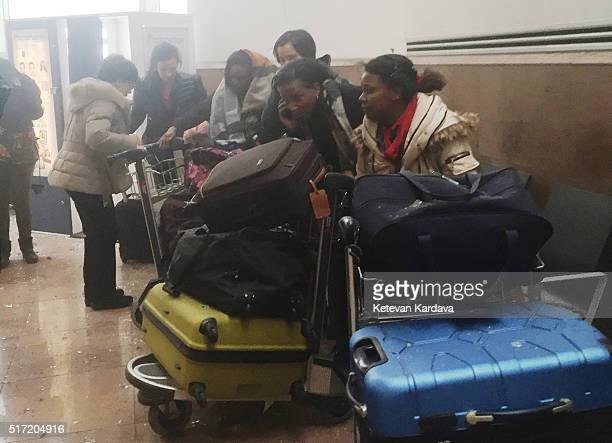 Passengers react following a suicide bombing at Brussels Zaventem airport on March 22, 2016 in Brussels, Belgium. Georgian journalist Ketevan...