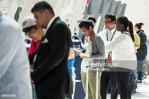 Passengers receive assistance from a Delta airline employee at Pearson International airport in Toronto Canada on August 8 2016 Passengers were left...