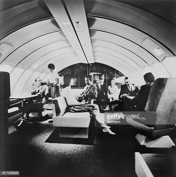 Passengers relax aboard the new Boeing Pan Am 747 jet transport