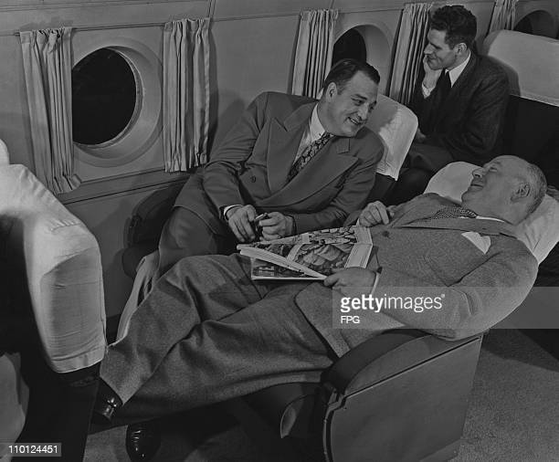 Passengers relaxing on an airline flight circa 1950