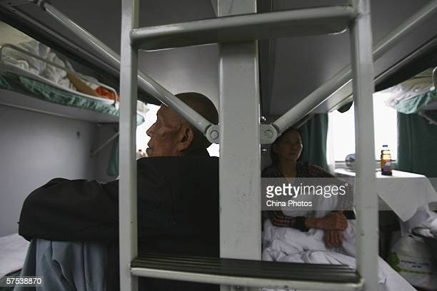 Passengers rest on a train bound for Xiamen from Chongqing on May 4 2006 in Chongqing Municipality China The Chinese government expects a record high...