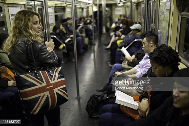 Passengers ride a Brooklyn bound subway April 20, 2011 in New York.