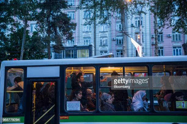 Passengers ride a bus in Dushanbe Tajikistan on Sunday April 22 2018 Flung into independence after the Soviet Union collapsed in 1991 the Stans'...