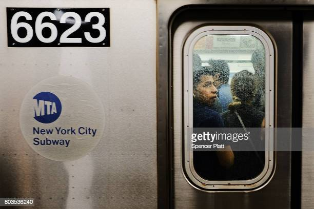 Passengers ride a Metropolitan Transportation Authority subway on June 29 2017 in New York City Following a series of breakdowns delays and political...