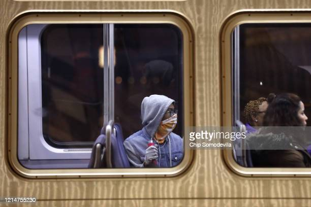 Passengers ride a train out of the Metro Center Station as ridership across the Metro train system is down nearly 90percent because of the...