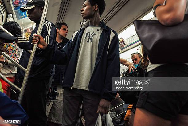 Passengers ride in a Metropolitan Transportation Authority subway car July 22 2014 in the Manhattan borough of New York