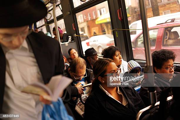 Passengers ride on the B46 bus on April 8 2014 in the Brooklyn borough of New York City The B46 bus which runs through parts of Crown Heights...