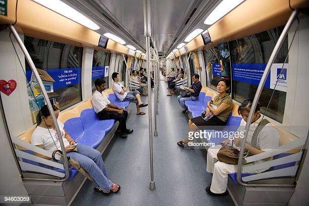 Passengers ride one of Singapore's subway trains in Singapore on Wednesday May 9 2007 SMRT Corp Singapore's biggest subway operator dropped after the...