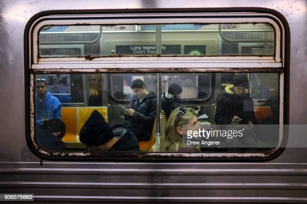 Passengers ride the G Train at the 7th Avenue subway station March 22 2018 in the Brooklyn borough of New York City According to a report by advocacy...