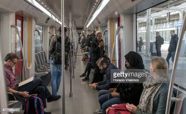 Passengers ride the Metro on April 20 2017 in Amsterdam Netherlands The city's Metro system was first introduced in 1977 It is a fast way of getting...
