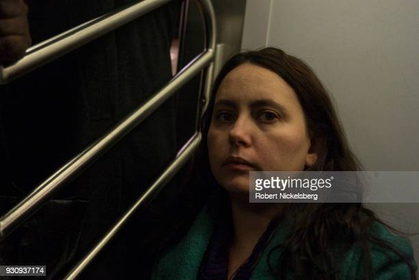 Passengers ride the subway March 8, 2018 in the Manhattan borough of New York. The New York subway system faces a deteriorating infrastructure with...