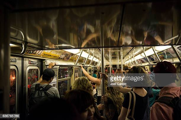 Passengers riding New York City subway