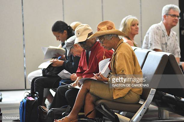 Passengers Robert and Marcheta Mines from Alameda California fill out paperwork shortly before baorsding the Fathom cruise ship Adonia as she departs...