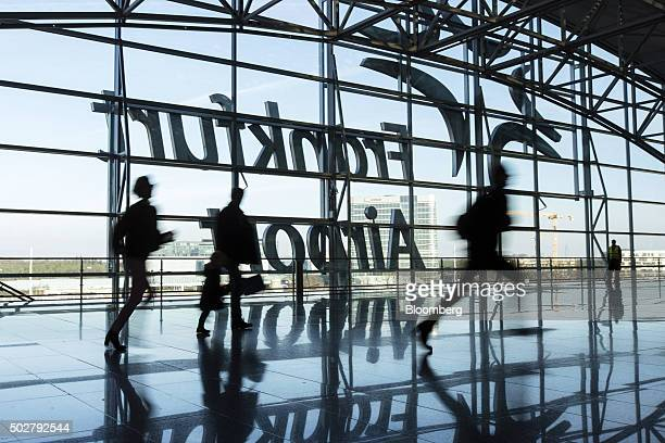 Passengers run for flights inside Terminal 2 at Frankfurt Airport operated by Fraport AG in Frankfurt Germany on Monday Dec 28 2015 European stocks...