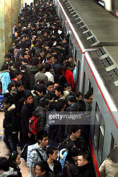 Passengers rush to board a crowded subway train in Beijing on February 22 2008 Selfish commuters who refuse to give up their seats to pregnant women...